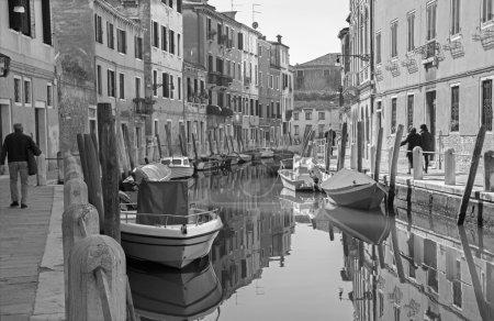 VENICE, ITALY - MARCH 12, 2014: Fondameneta delle Eremite street and canal Rio delle Eremite
