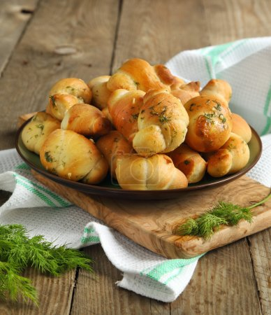 Photo for Garlic bread buns seasoned with dill - Royalty Free Image