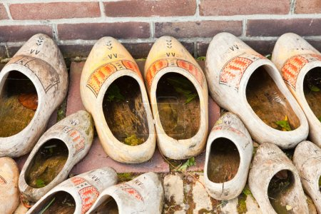 A lot of old dutch wooden shoes.