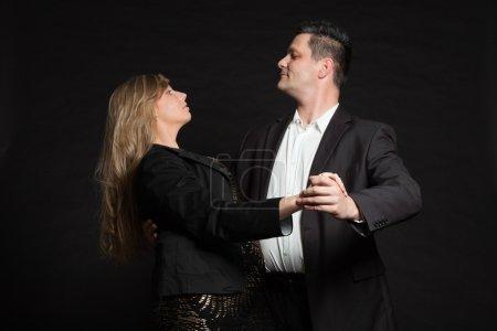 Couple in love. Studio shot against black.