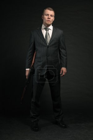 Mafia man with gun.