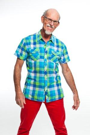Studio portrait of active senior well dressed retired man.