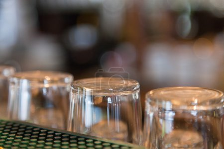 Empty beer glasses on bar....