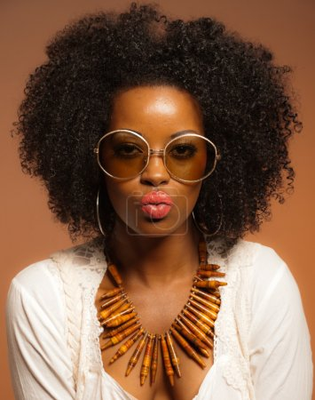 Retro 70s fashion black woman with sunglasses and white shirt. B