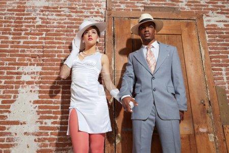 Vintage jazz fashion sexy wedding couple in old urban building.