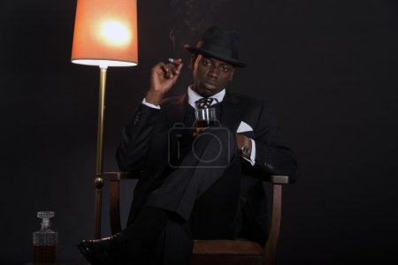 Retro african american gangster man wearing striped suit and tie