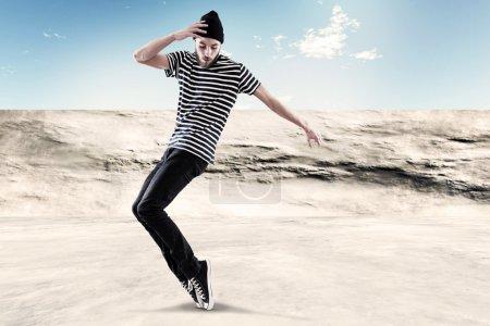 Street dancing man urban fashion with beard. Wearing black woole