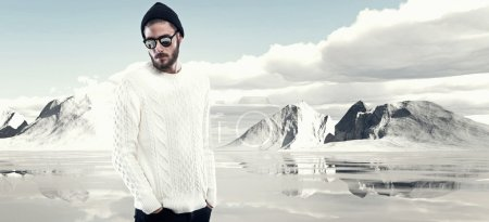 Cool man with beard in winter fashion. Wearing white woolen swea