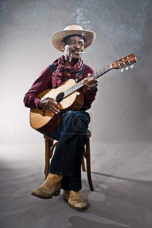 Retro senior afro american blues man in times of slavery. Wearin