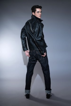 Retro rock and roll 50s fashion man with dark grease hair. Weari