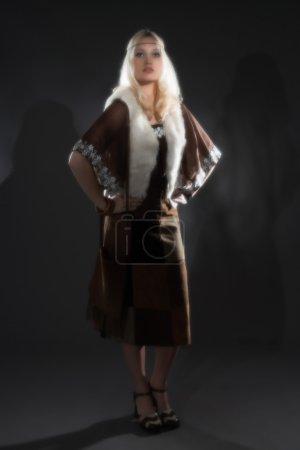 Retro soft focus hippie 70s fashion festival girl with long blon