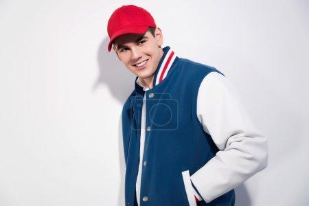 Smiling retro fifties sportive fashion man wearing...