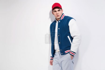 Retro fifties sportive fashion man wearing blue baseball jacket