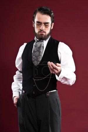 Retro 1900 victorian fashion man with beard wearing black gilet