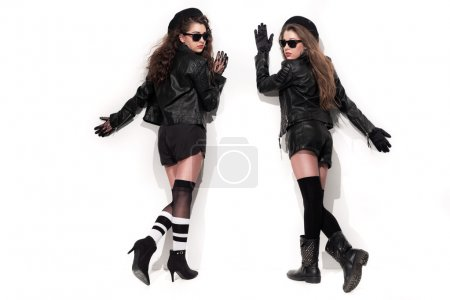 Two bold eighties fashion girls with sunglasses in black and whi