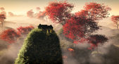 Aerial of fantasy grassy hill landscape with red autumn trees an