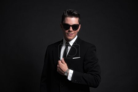 Retro fifties fashion man wearing black sunglasses with suit and