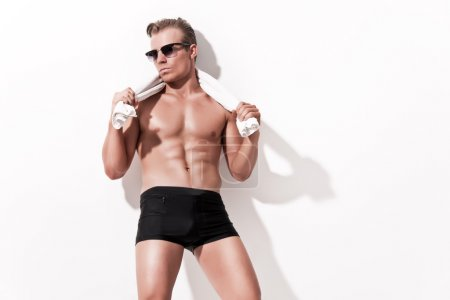 Male fitness underwear model wearing black shorts and vintage su