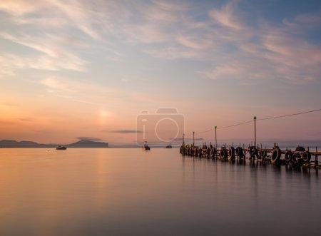 Jetty on sea at dawn