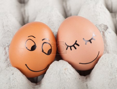 Photo for Two funny smiling eggs in a packet. - Royalty Free Image