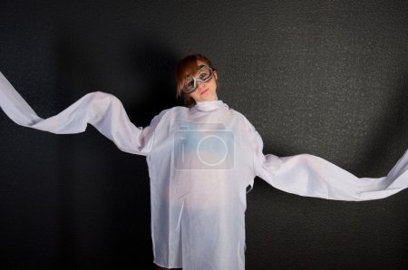 Photo for Young insane woman with straitjacket with pilot glasses over dark background - Royalty Free Image
