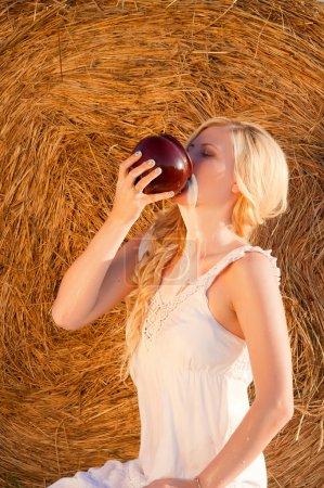 Sexy blonde woman drinking milk