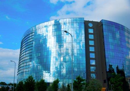 Modern office glass building over blue sky
