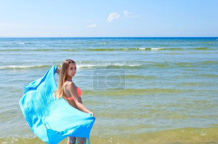 Beautiful Girl With blue Scarf on The Beach.