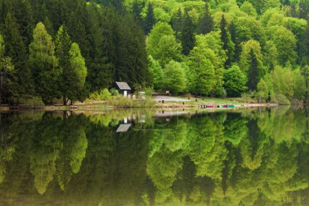 Saint Ana Lake in Romania - House on a lake with reflation into