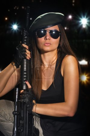 Army girl in glasses in the night