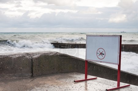 Photo for Warning tablet on the waterfront in the storm - Royalty Free Image