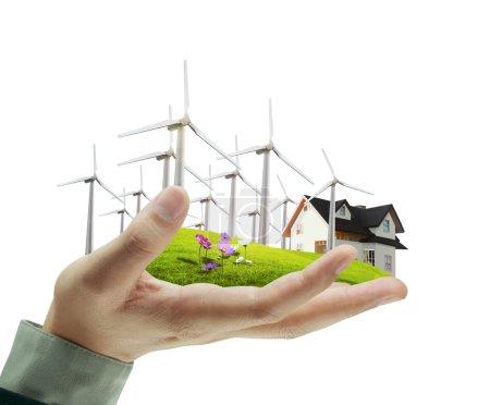 Photo pour Éolienne en main homme d'affaires - image libre de droit