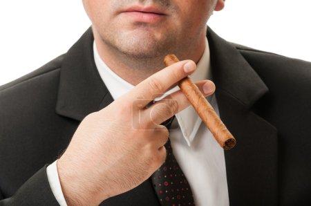 Confident business man holding a cuban ciga