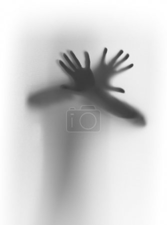 Photo pour Silhouette humaine derrière un rideau, les mains et les bras - image libre de droit