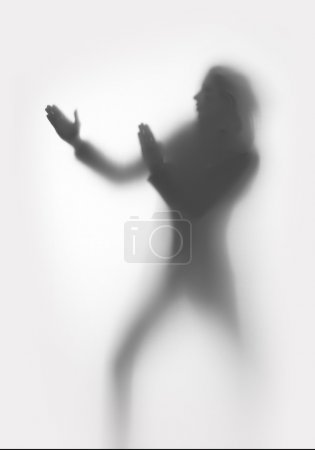 Photo for Woman silhouette protects herself - Royalty Free Image