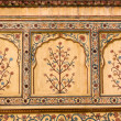 Indian ornament on wall of palace in Jaipur fort I...