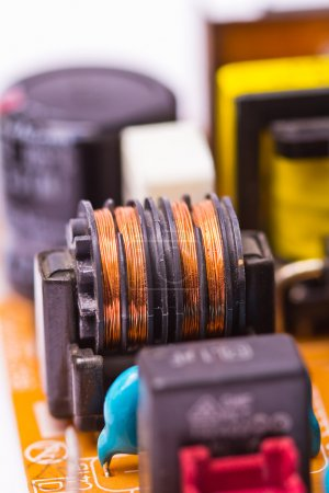 Photo for Copper coil electronic components on printed circuit board - Royalty Free Image