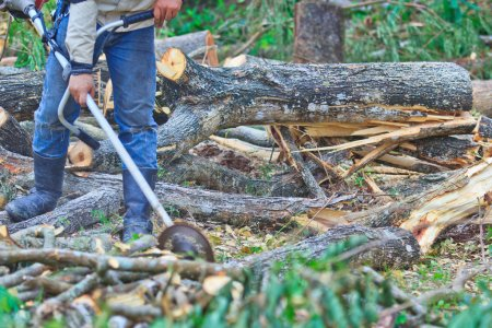 Man cutting piece of wood