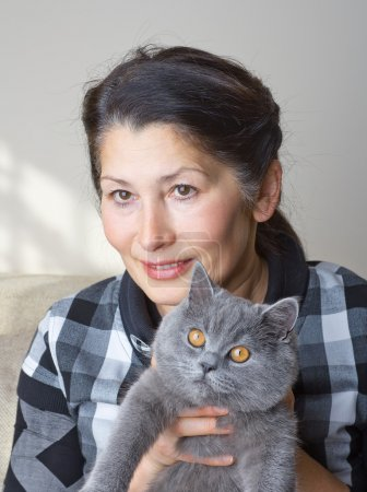 Pretty woman with a cat