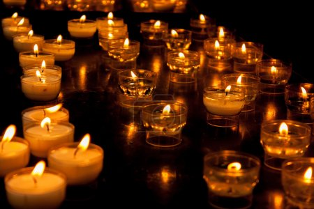 Photo for Romantic glowing long row of candlelight burning - Royalty Free Image