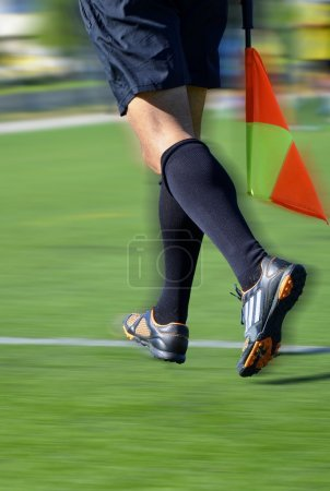 Soccer line judge with flag