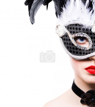 Beautiful young woman in black carnival mask