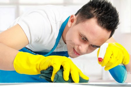 Photo for Portrait of man doing some cleaning work in the house - Royalty Free Image