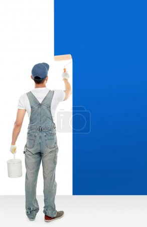painter painting some walls with blue paint