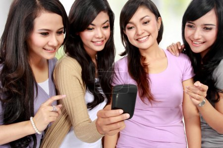 women friends at home using handphone