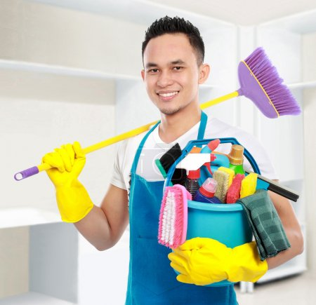 Photo for Portrait of man with cleaning equipment cleaning the house - Royalty Free Image