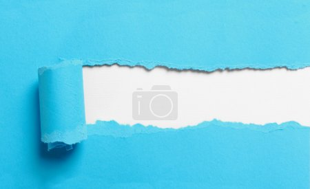 ripped blue paper