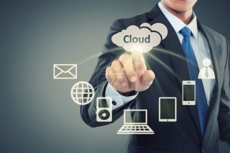 Photo for Business man pointing at cloud computing on virtual background - Royalty Free Image