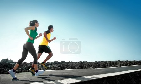 Photo for Sport - asian couple running outdoor doing exercise - Royalty Free Image