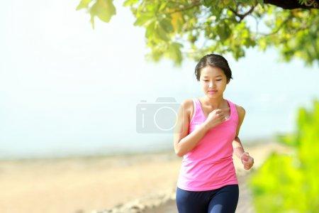 beautiful girl jogging on the beach